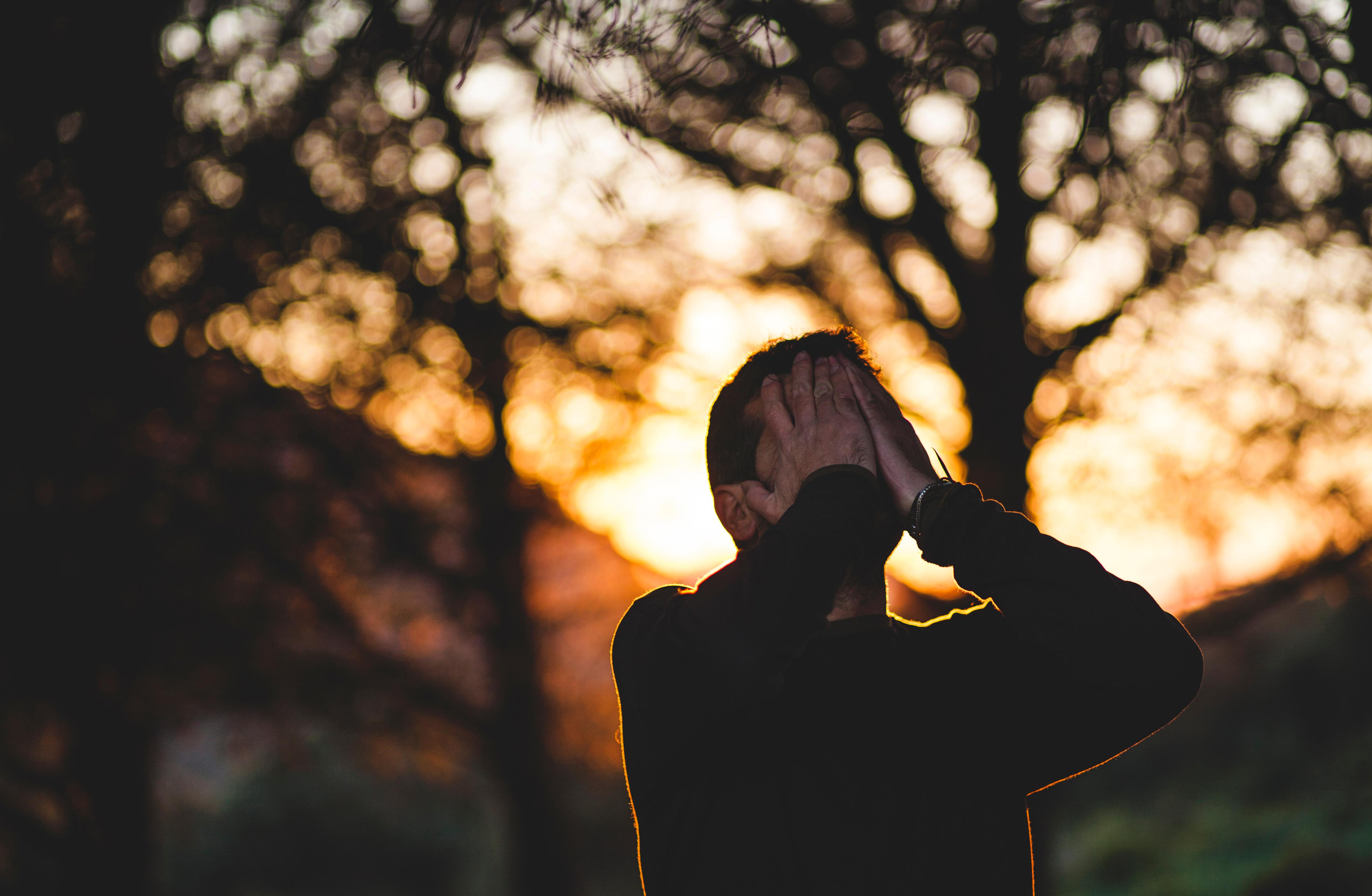 A man praying/confessing his sins